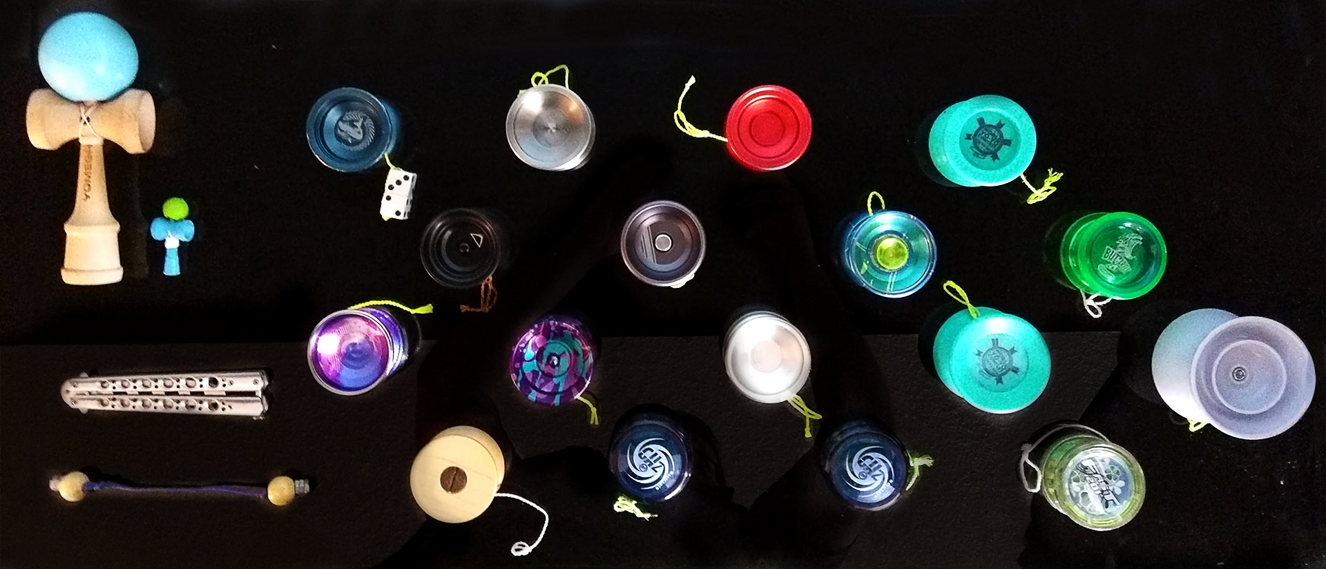 A series of yoyos and other skill toys arranged in a grid